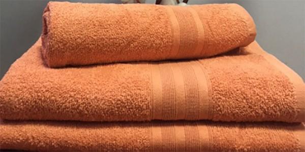 Махровое полотенце 50х90 см кораллового цвета 420 г/м2