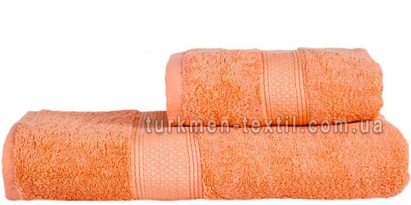 Махровое полотенце 50х100 см кораллового цвета 550 г/м2
