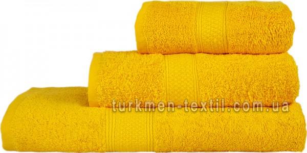Махровое полотенце 50х70 см желтого цвета 550 г/м2